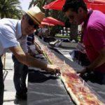 Motril hace la tostada con jamón más larga de España